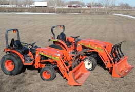 Two Kabota front end loaders